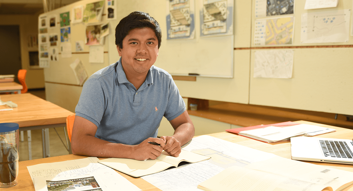 Prospective Student at Desk