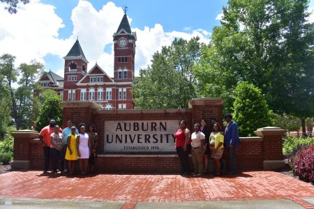 McNair Scholars in front of the Auburn University sign